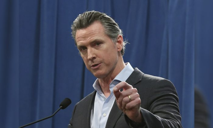 Calif. Gov. Gavin Newsom answers questions at a Capitol news conference, in Sacramento, Calif. (Rich Pedroncelli/AP)