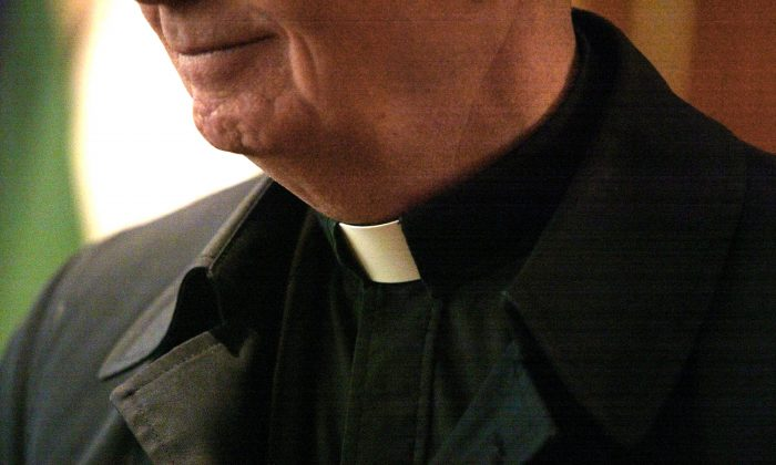 The collar of a priest is seen at St. Adalbert Catholic Church March 29, 2002, in Chicago. (Tim Boyle/Getty Images)