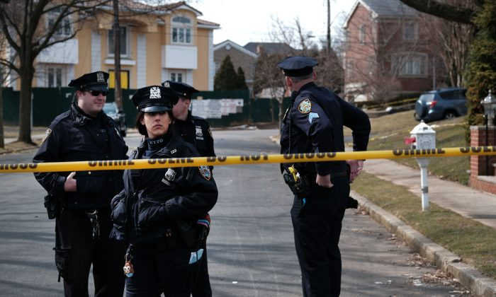 "Police stand along the street where reputed mob boss Francesco ""Franky Boy"" Cali lived and was gunned down on March 14, 2019 in the Todt Hill neighborhood of the Staten Island borough of New York City. (Spencer Platt/Getty Images)"
