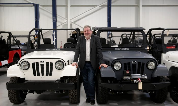 Mahindra Automotive North America President and CEO Rick Haas poses next to ROXOR off-road vehicles in the MANA assembly plant in Auburn Hills, Michigan, U.S., January 30, 2019.   REUTERS/Rebecca Cook