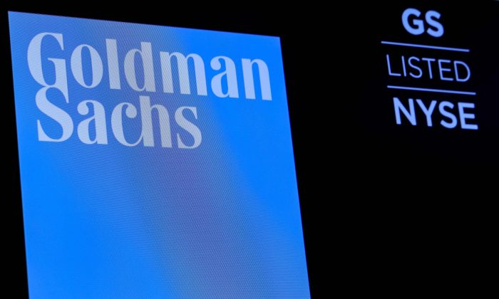 FILE PHOTO: The ticker symbol and logo for Goldman Sachs is displayed on a screen on the floor at the New York Stock Exchange (NYSE) in New York, U.S., December 18, 2018. REUTERS/Brendan McDermid