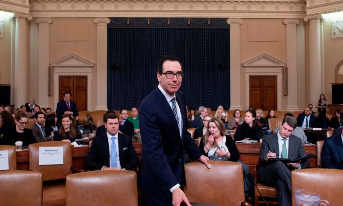 """Treasury Secretary Steven Mnuchin arrives to testify on """"The President's FY2020 Budget Proposal"""" before the House Ways and Means Committee on Capitol Hill in Washington, DC, on March 14, 2019. (JIM WATSON/AFP/Getty Images)"""