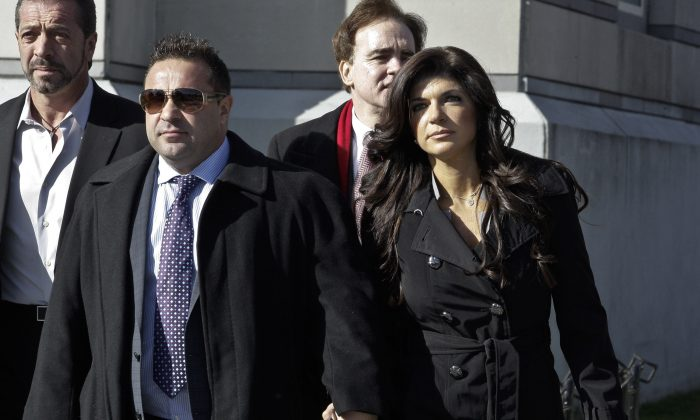 Teresa Giudice and her husband Giuseppe 'Joe' Giudice (L) leave Newark federal court on November 20, 2013 in Newark, New Jersey. Joe finished serving a 41-month prison sentence on March 14, 2019, and was immediately transferred into the custody of Immigration and Customs Enforcement. (Kena Betancur/Getty Images)