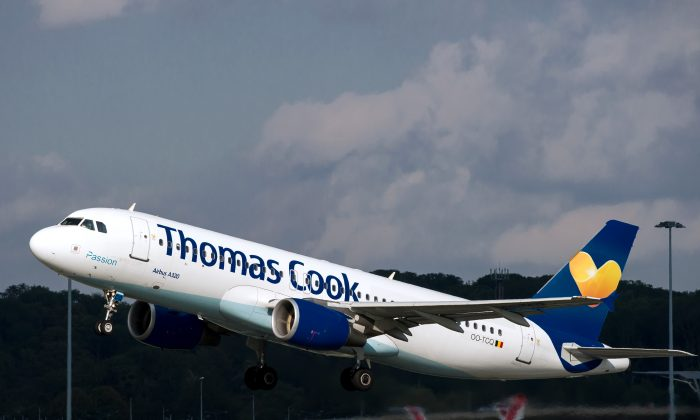 A Thomas Cook jet takes off on at the Lille-Lesquin airport, northern France on Oct. 11, 2014.     (Philippe Huguen/AFP/Getty Images)