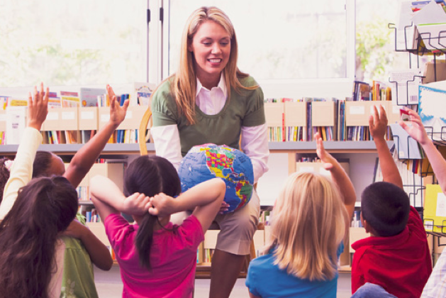 Teacher talking to students. (Monkey Business Images/Shutterstock)