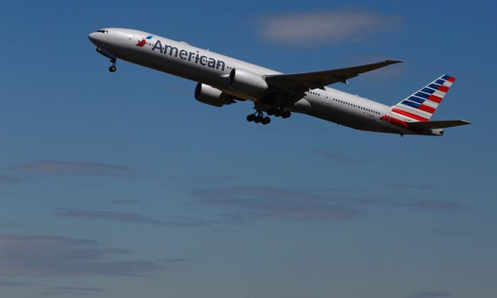 An American Airlines airplane takes off from Heathrow airport in London on July 3, 2014. (Reuters/Luke MacGregor)