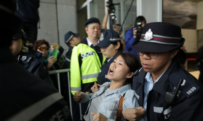 A protester is arrested by police after storming Hong Kong government headquarters over a proposal to extradite fugitives to mainland China, in Hong Kong, China  on March 15, 2019. (Stanley Leung/Reuters)