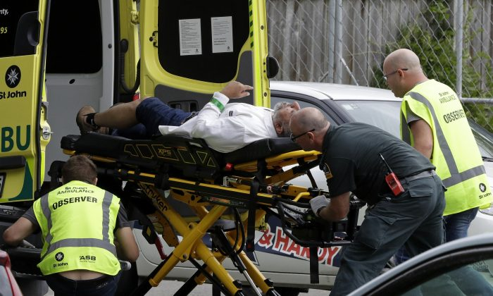 Ambulance staff take a man from outside a mosque in central Christchurch, New Zealand, on March 15, 2019. (Mark Baker/AP Photo)