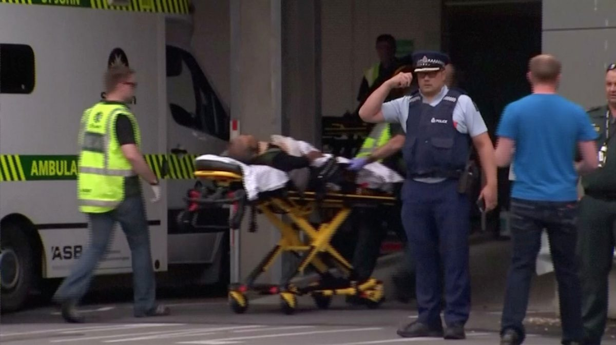 a stretcher carrying a person at a hospital, after reports that several shots had been fired, in central Christchurch