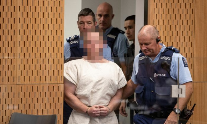 Brenton Tarrant, charged for murder in relation to the mosque attacks, is led into the dock for his appearance in the Christchurch District Court, New Zealand, on March 16, 2019. (Mark Mitchell/New Zealand Herald/Pool via Reuters)