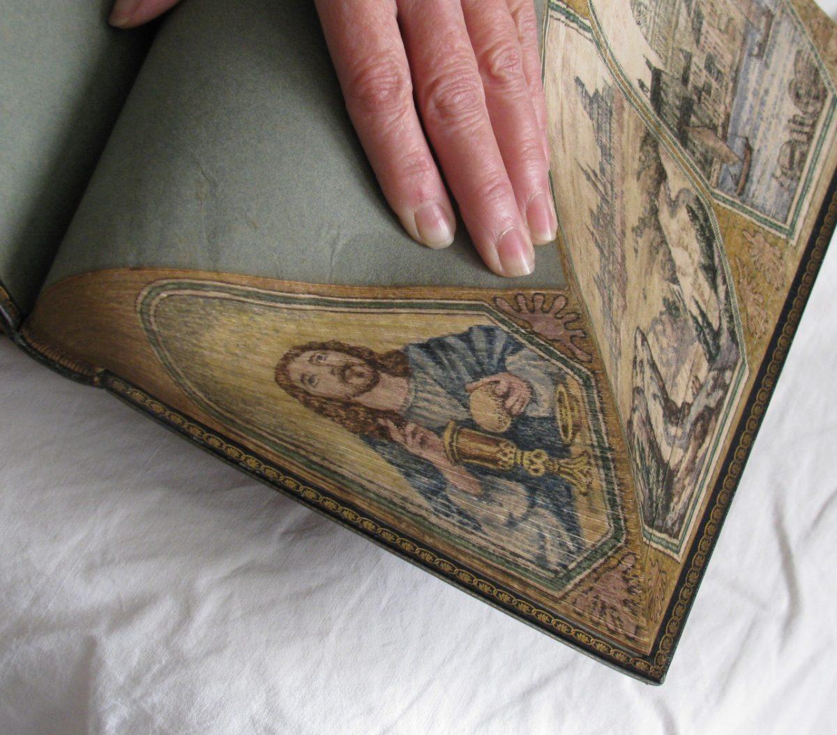 Jesus painting on book