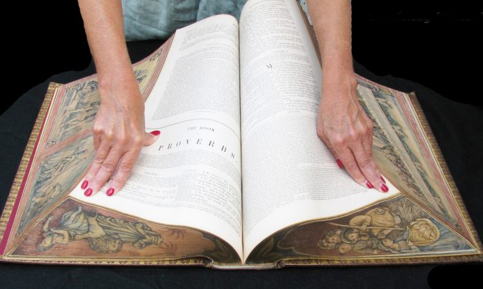 Vanishing fore-edge paintings are on all the edges of this family Bible; the images are revealed when the book is twisted, as in this photo. (Foredgefrost)