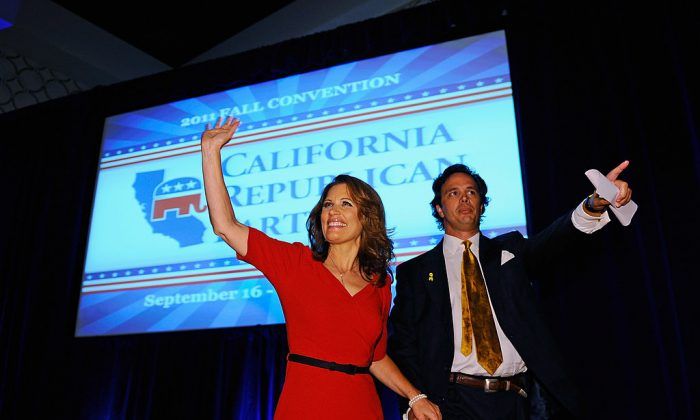 Republican presidential candidate Michele Bachmann (R-MN), escorted by California Republican Party chairman Tom Del Beccaro, arrives to deliver a speech to the California Republican Party Convention banquet Sept. 16, 2011. (Kevork Djansezian/Getty Images)