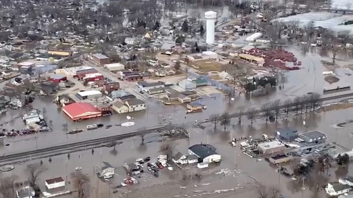 An aerial view of damaged buildings after a storm triggered historic flooding in Valley Nebraska