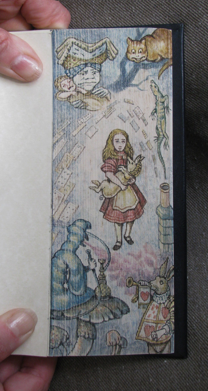 Alice and rabbit painted on book