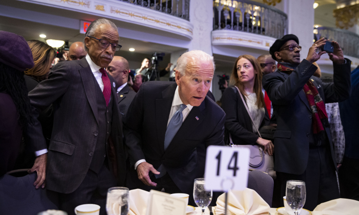 Rev. Al Sharpton (L), and former Vice President Joe Biden during the National Action Network Breakfast on Jan. 21, 2019, in Washington. (Al Drago/Getty Images)
