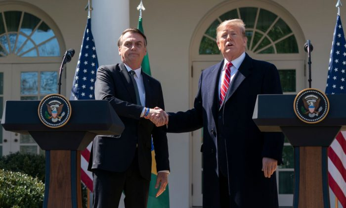 U.S. President Donald Trump and Brazilian President Jair Bolsonaro attend a joint news conference in the Rose Garden at the White House in Washington, on March 19, 2019. (Chris Kleponis-Pool/Getty Images)