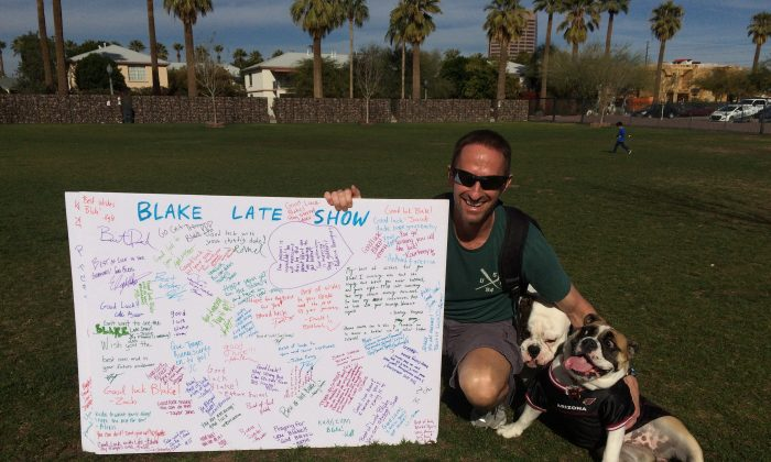Ron Blake with one of his poster boards. He's been on a journey throughout the country to remove the stigma around mental illness. (Courtesy of Ron Blake)