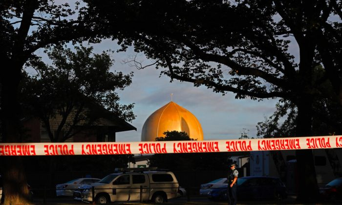 A police officer stands guard in front of the Masjid Al Noor mosque in Christchurch, New Zealand on March 17, 2019, where one of two mass shootings occurred. (Vincent Yu/AP Photo)