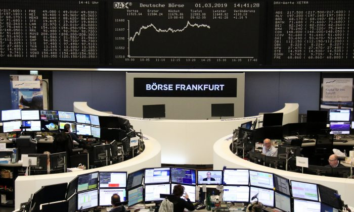 FILE PHOTO: The German share price index DAX graph is pictured at the stock exchange in Frankfurt, Germany, March 1, 2019.    REUTERS/Staff