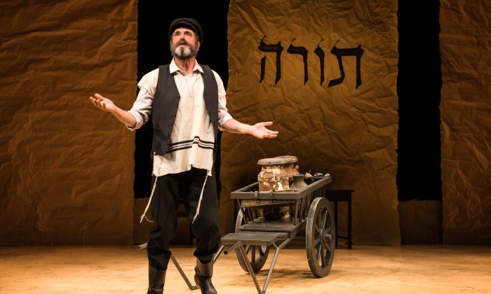 "Tevye (Steven Skybell) and his milkcart, in the Yiddish production of ""Fiddler on the Roof"" directed by Joel Grey. (Matthew Murphy)"