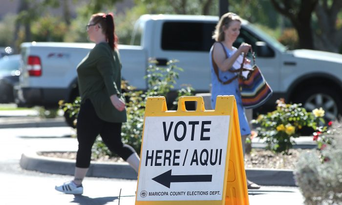 Arizona voters make their way to a polling place to cast their ballot during the midterm elections, Phoenix, Arizona, on Nov. 6, 2018. (Ralph Freso/Getty Images)