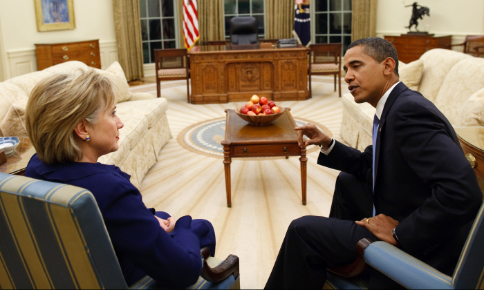 Then-President Barack Obama talks with his Secretary of State Hillary Rodham Clinton in the Oval Office of the White House on January 21, 2009. (Pete Souza/White House via Getty Images)