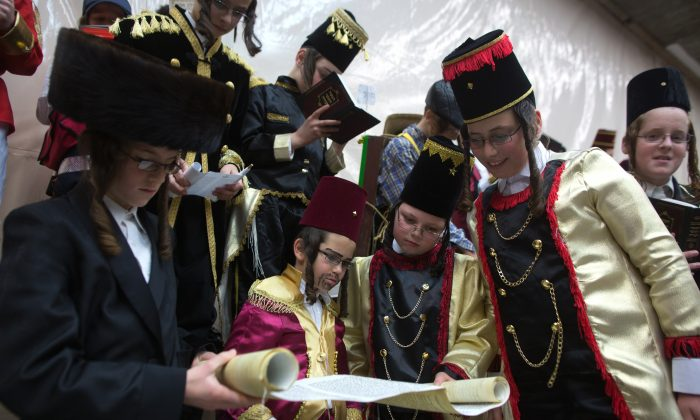 Ultra-Orthodox Jewish boys wearing costumes read the book of Esther at a synagogue in the Israeli city of Bnei Brak near the costal city of Tel Aviv on March 4, 2015 during the feast of Purim. MENAHEM KAHANA/AFP/Getty Images