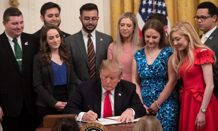 President Donald Trump signs an executive order to protect free speech on college campuses during a ceremony in the East Room of the White House in Washington, March 21, 2019. (SAUL LOEB/AFP/Getty Images)