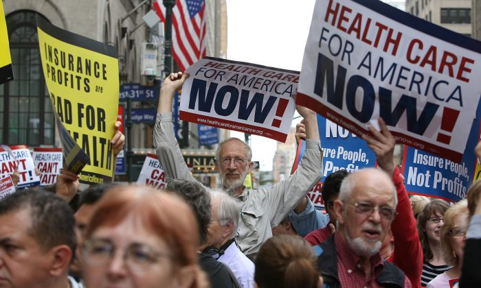 """Health care reform supporters protest at a """"Big Insurance: Sick of It"""" rally in New York City on Sept. 22, 2009. (Mario Tama/Getty Images)"""