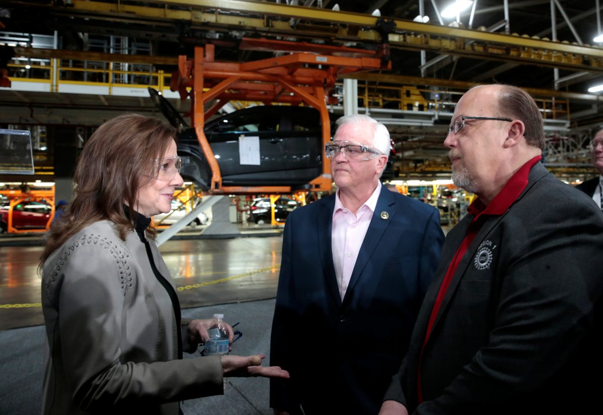 General Motors Chief Executive Officer Mary Barra (L) talks with United Auto Workers Union Vice President Terry Dittes and UAW Region 1 Director Frank ...