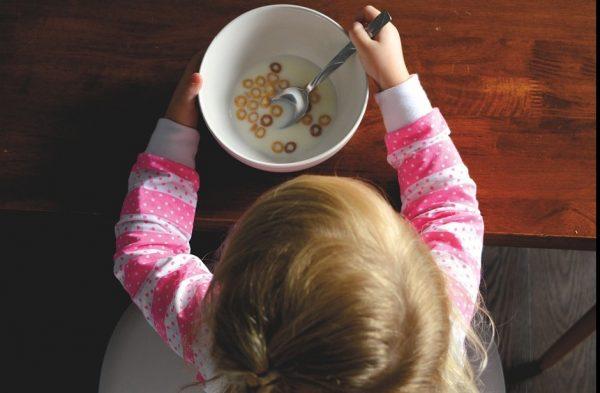 Child eating Cheerios