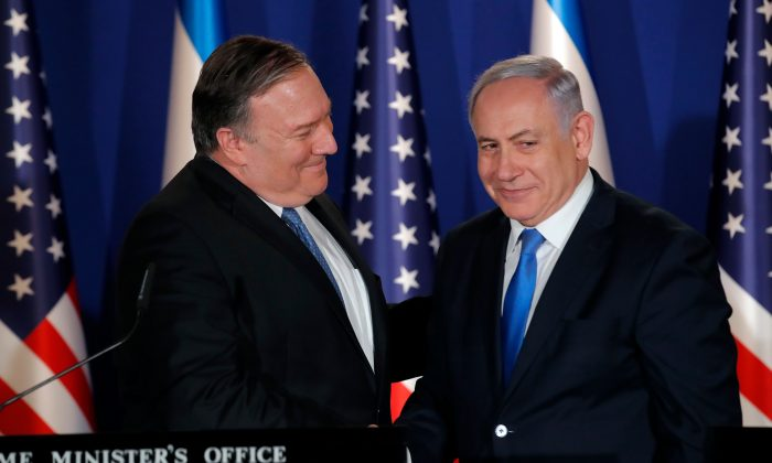 Israeli Prime Minister Benjamin Netanyahu (R) welcomes US Secretary of State Mike Pompeo to his residence in Jerusalem on March 21, 2019. (Jim Young/AFP/Getty Images)