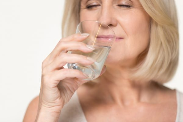 Many benefits to your body if you drink more water (Fizkes/Shutterstock)
