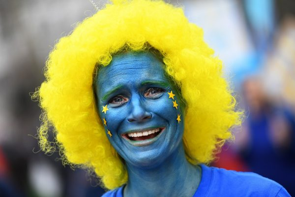 An EU supporter with her face painted, calling on the government to give Britons a vote