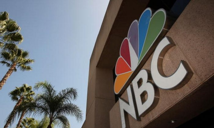 The NBC peacock logo hangs on the NBC studios building in Burbank, California, on Oct. 20, 2008. (David McNew/Getty Images)