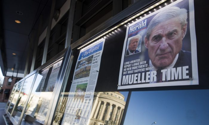 Newspaper front pages from around the nation are on display at the Newseum in Washington, on March 23, 2019. (Alex Brandon/AP Photo)