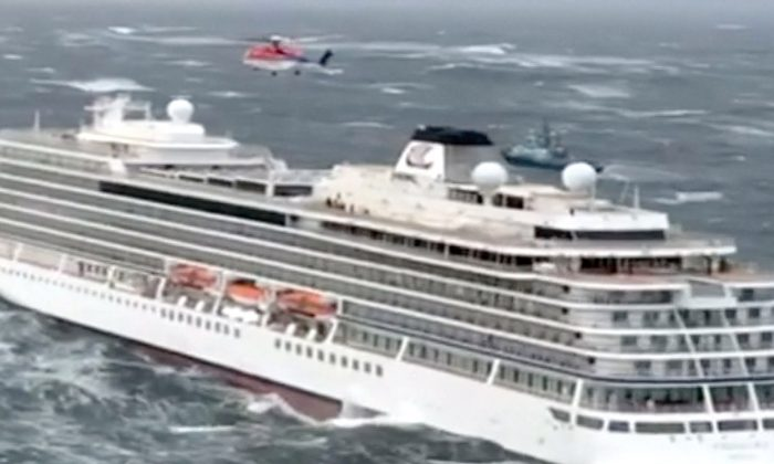 Viking Sky cruise ship with helicopters hovering above it in Hustadvika, Norway, on March 23, 2019 (CHC Helicopters via Reuters)