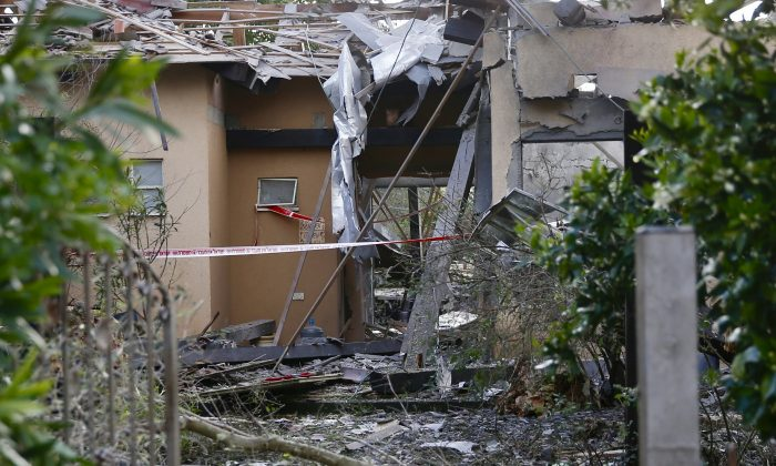 Damage to a house hit by a rocket is seen in Mishmeret, central Israel, on March 25, 2019. (Ariel Schalit/AP Photo)