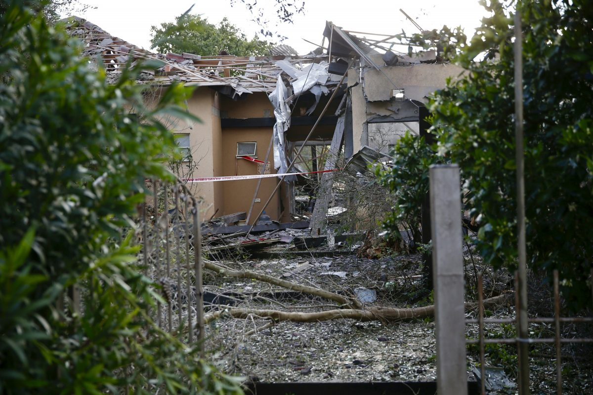 Damage to a house hit by a rocket, in Israel