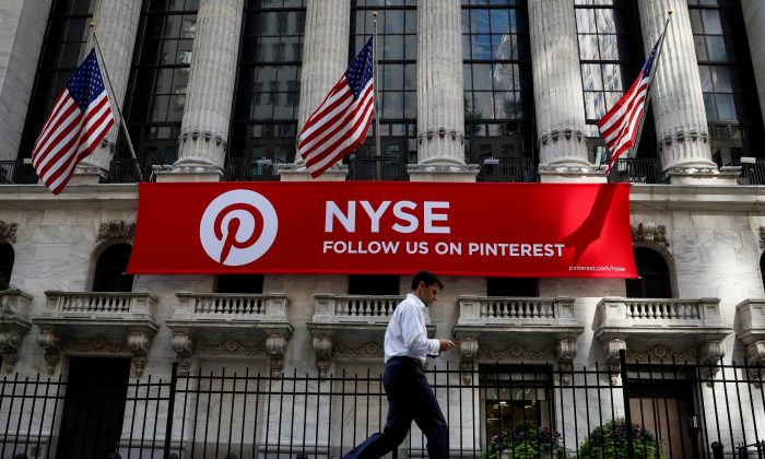 A Pinterest banner hangs on the facade of the New York Stock Exchange (NYSE) in New York City, U.S., September 22, 2017. REUTERS/Brendan McDermid