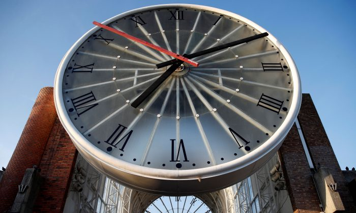 A giant clock at Cergy-Saint-Christophe railway station near Paris. More and more nations are abolishing Daylight Saving Time, for good reasons. (REUTERS/Christian Hartmann)