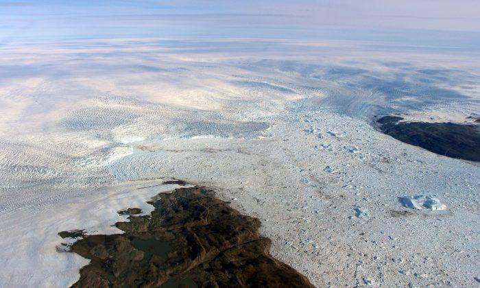 Patches of bare land at the Jakobshavn glacier in Greenland, in 2016. (NASA via AP)