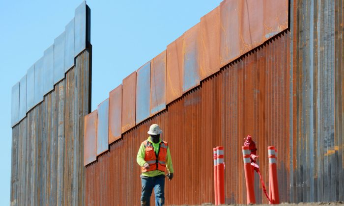 Construction workers build a secondary border wall in Otay Mesa, Calif., on Feb. 22, 2019. (Sandy Huffaker/Getty Images)