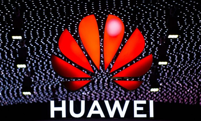 A Huawei logo seen above the company's booth booth at the GSMA Mobile World Congress in Barcelona on Feb. 26, 2019. (David Ramos/Getty Images)