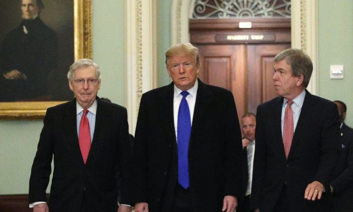 President Donald Trump (C) walks with Senate Majority Leader Sen. Mitch McConnell (R-KY) (L), and Sen. Roy Blunt (R-MO) (R) as he arrives at the Capitol on March 26, 2019. (Alex Wong/Getty Images)