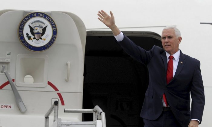 Vice President Mike Pence waves from Air Force Two as he arrives in Huntsville to chair the fifth National Space Council meeting held at the U.S. Space and Rocket Center in Huntsville, Ala., on March 26, 2019. (Eric Schultz/AP Photo)