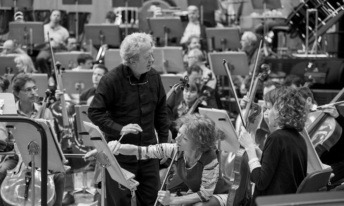 """John Nelson with the Strasbourg Philharmonic orchestra, preparing """"Les Troyens.""""(Gregory Massat)"""
