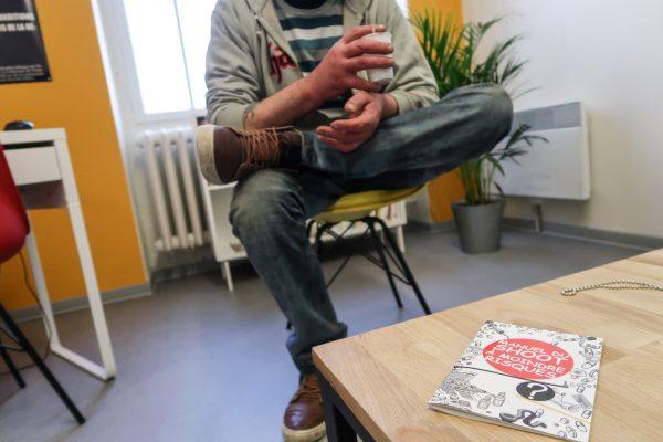 Loic, a drug user, speaks to a journalist