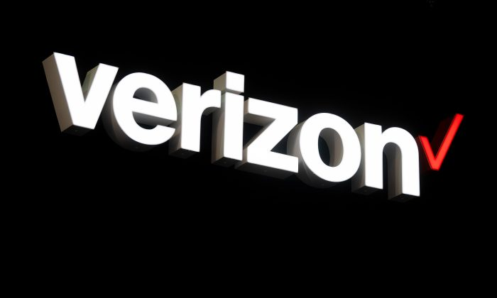 BARCELONA, SPAIN - FEBRUARY 26:  A logo sits illumintated outside the Verizon booth on day 2 of the GSMA Mobile World Congress 2019 on February 26, 2019 in Barcelona, Spain. The annual Mobile World Congress hosts some of the world's largest communications companies, with many unveiling their latest phones and wearables gadgets like foldable screens and the introduction of the 5G wireless networks. (Photo by David Ramos/Getty Images)